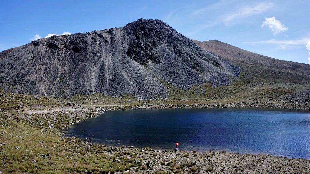 Zoe dwarfed by the impressive Nevado de Toluca